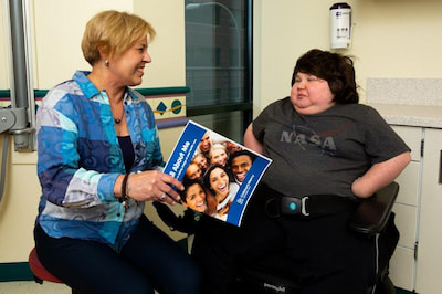A young adult patient talks with Dr. Ann Modricin of Children's Mercy Kansas City.
