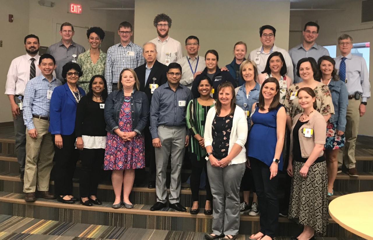 A group photo of the faculty and fellows of the Neonatal-Perinatal Medicine Fellowship at Children's Mercy.
