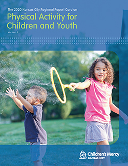 """Two children playing with bubbles outside with words that read, """"The 2020 Kansas City Regional Report Card on Physical Activity for Children and Youth, Volume 1."""""""