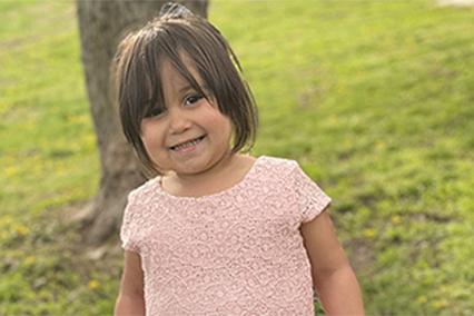 Cambree Alvarez smiling in a pink dress.