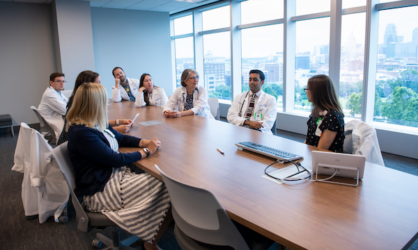 Several physicians are gathered around a conference table at Children's Mercy Kansas City