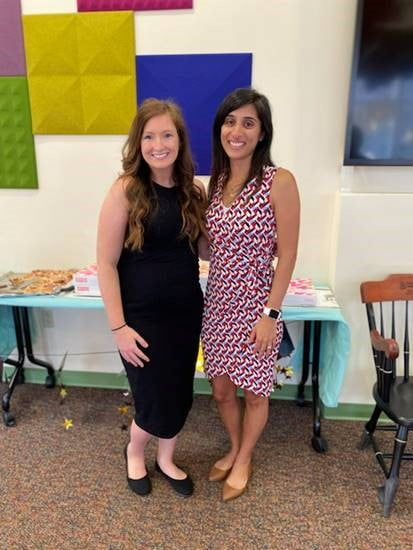 Two women stand together at the Pediatric Hematology Oncology Fellowship graduation.