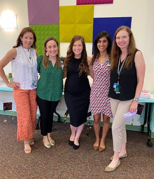 Five women stand together at the Pediatric Hematology Oncology Fellowship graduation.