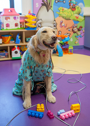 Hope plays in the playroom in the EMU at Children's Mercy.
