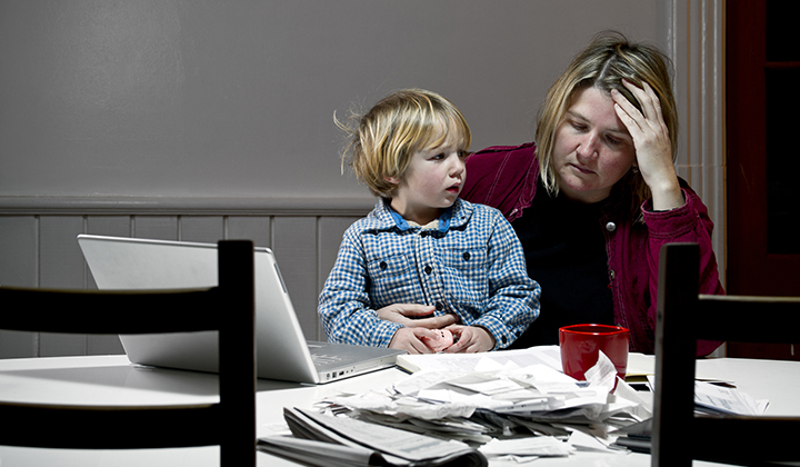 Mom at table frustrated looking at papers