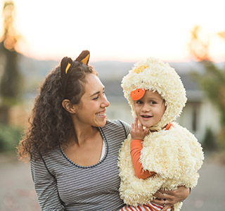 Mom holding child in chicken costume