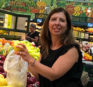 woman grocery shopping on a budget
