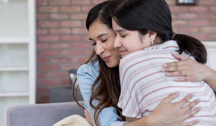 mom hugging daughter