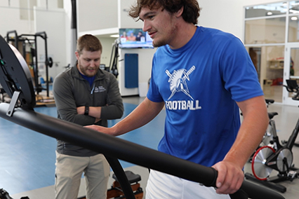 Michael Shultz on treadmill while physical therapist watches in background
