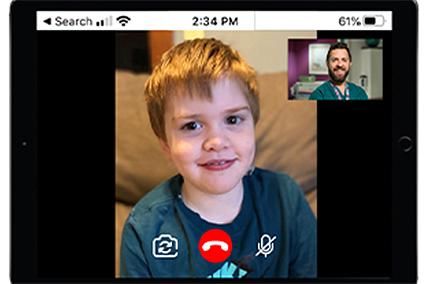 TJ having a telemedicine visit with Dr. John Rosen