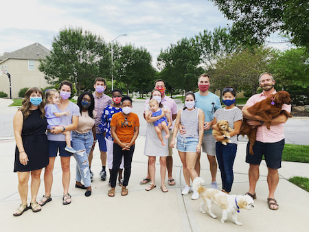 Children's Mercy Pediatric Residents pose with family members and pets.
