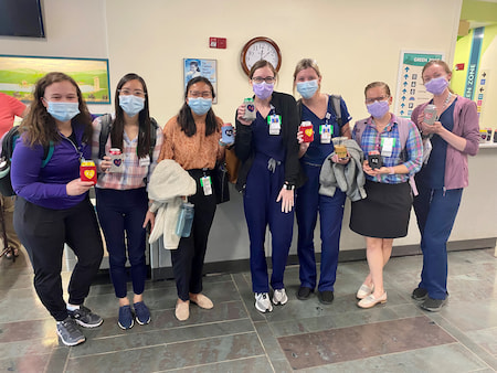 Children's Mercy Pediatric Residents pose with KC drink holders