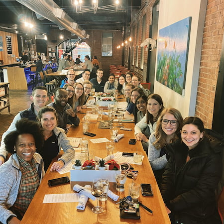 Children's Mercy Pediatric Residents enjoy a meal together at a restaurant