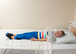 A child lays still for their test in the Kidney Center at Children's Mercy,
