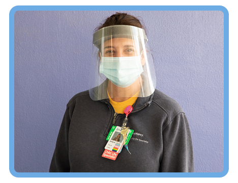 Child Life specialist in face shield and mask