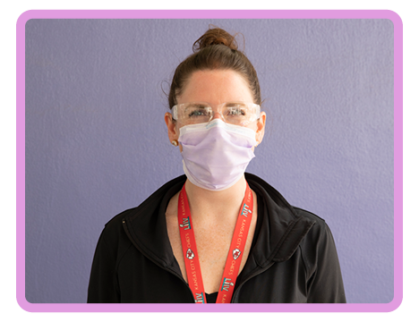 Children's Mercy staff member in protective glasses and face mask
