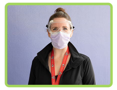 Children's Mercy staff member in protective eye googles and face mask